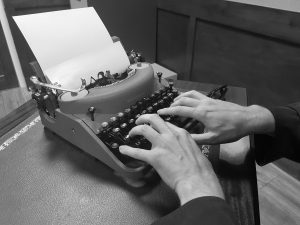 hands on typewriter